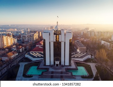 CHISINAU, MOLDOVA - MARCH 13, 2019: Aerial drone view of Presidency building with light at sunrise and blue sky