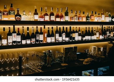 Chisinau, Moldova - March 15, 2021: Various bottles with alcohol on shelves at a bar.