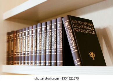"Chisinau, Moldova - March 2019: Encyclopedia Britannica - Complete stack of ""Enciclopedia Universală Britanica"" composed of 16 volumes in romanian language."
