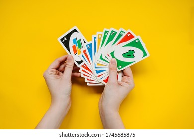 Chisinau, Moldova - May 30, 2020: female hands holding Uno game cards.