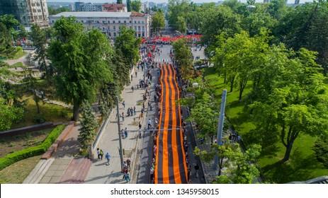 Chisinau, Chisinau / Moldova - may 9 2018: victory day, people are holding giant ribbon of Saint George  in Chisinau, Moldova, shot from above drone