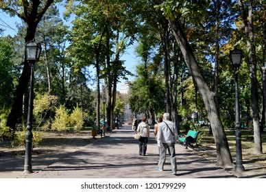CHISINAU, MOLDOVA - OCTOBER 6, 2018: Weekend vistors stroll the leafy Stefan cel Mare park in the cty centre, one of the greenest in Europe,