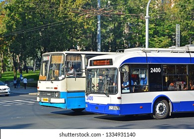 CHISINAU, MOLDOVA - SEPTEMBER 1, 2017 - Chisinau public transport with an old Ikarus bus and new Belkommunmash trolleybus in the city centre