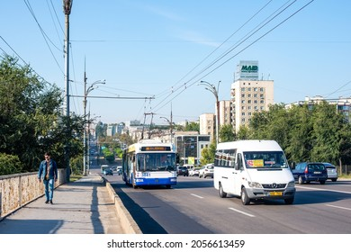 CHISINAU, MOLDOVA - September 13, 2021. Trolleybus BKM 321 #3841 and bus Mercedes-Benz Sprinter 313 riding with passengers in the streets of Chisinau.