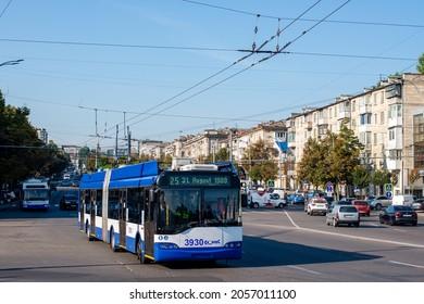 CHISINAU, MOLDOVA - September 13, 2021. Trolleybuses Solaris Trollino 18 #3930 (ex. Riga #16022) and BKM 321 #3861 riding with passengers in the streets of Chisinau.