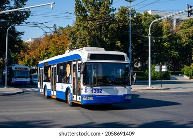 CHISINAU, MOLDOVA - September 13, 2021. Trolleybuses BKM 321 #1302 and RTEC 62321 (BKM) #2411 riding with passengers in the streets of Chisinau.