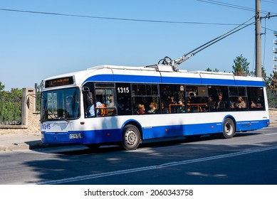 CHISINAU, MOLDOVA - September 13, 2021. Trolleybus BKM 321 #1315 riding with passengers in the streets of Chisinau.