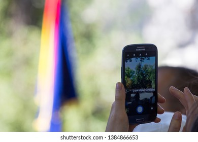 Chisinau, Rep. of Moldova - August 27, 2016: Girl taking pictures of the Independence Day parade in Chisinau, Moldova
