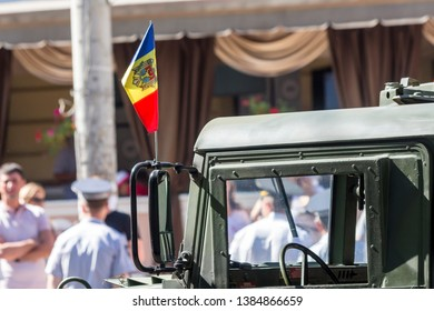 Chisinau, Rep. of Moldova - August 27, 2016: Military car waving a Moldavian flag on the Stefan cel Mare si Sfant street during the Independence Day Parade in Chisinau, Moldova