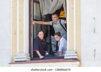 Chisinau, Rep. of Moldova - August 27, 2016: People watching the march of the soldiers from the window during Independence Day parade in Chisinau, Moldova