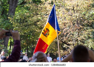 Chisinau, Rep. of Moldova - August 27, 2016: Moldavian flag carried through the main street of Chisinau, Moldova during Independence Day celebrations