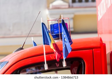 Chisinau, Rep. of Moldova - August 27, 2016: Firefighter truck with the Moldavian and the EU flags driving through the main street of Chisinau, Moldova during Independence Day celebrations