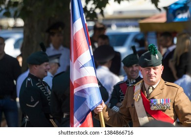 Chisinau, Rep. of Moldova - August 27, 2016: Irish Royal Regiment holding the United Kingdom flag before marching on the main street of Chisinau, Moldova during Independence Day Parade