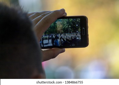 Chisinau, Rep. of Moldova - August 27, 2016: Man shooting a video of the Independence Day march in Chisinau, Moldova