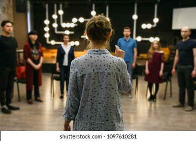 Chisinau, Republic of Moldova - April 30, 2018: Teacher of acting or business coach stands back in front of a group of students. Horizontally framed shot.