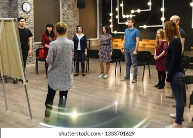 Chisinau, Republic of Moldova - April 30, 2018: Teacher of acting or business coach stands back in front of a group of students.