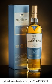 Chisinau, Republic of Moldova - February 20, 2017: Macallan highland single malt scotch whisky on yellow background in Chisinau, Republic of Moldova. Photo.