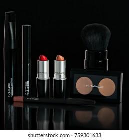 Chisinau, Republic of Moldova - October 11, 2016: Set company Mac makeup. Lipstick, mascara, powder, brush, pencil On a black background Photo