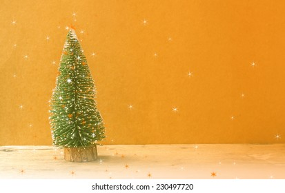 Chistmas tree,on wooden background,filter color editing.