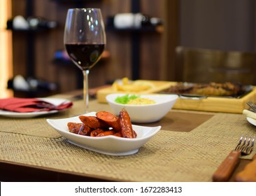 chistorras with wine glass wooden background steak house