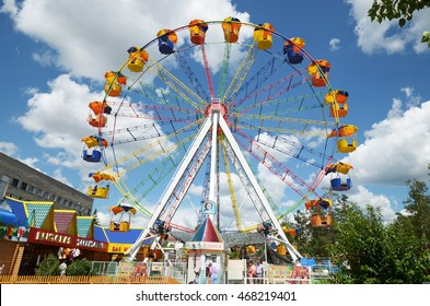 Chita, RU - Jul.17,2014: Ferris wheel in summer park of culture and recreation in the city of Chita, Russia
