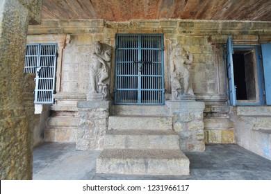 Chitharal Jain temple, Bhagwathi Temple, cave temple, Thiruchanattu Malai near Chitharal village, Kanyakumari, Tamil Nadu, India. View of the steps, entrance and dwarapalakas in front of the idols.