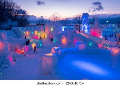 Chitose, Hokkaido, Japan - February 2018 : Lake Shikotsu Ice Festival,an ice sculpture event held in Lake Shikotsu hot springs in Shikotsu-Toya National Park with lights illuminating ice sculptures