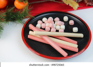 Chitoseame /a long stick of red and white candy sold at children's festivals