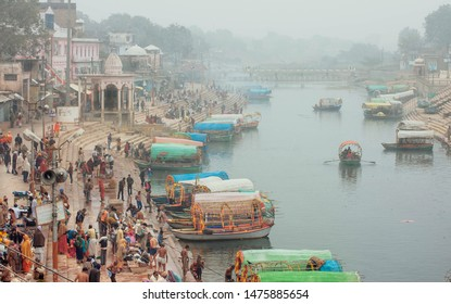 CHITRAKOOT, INDIA: Misty morning in city with crowd of business people and many riverboats on indian river on December 27, 2018. Madhya Pradesh is the second largest Indian state by area