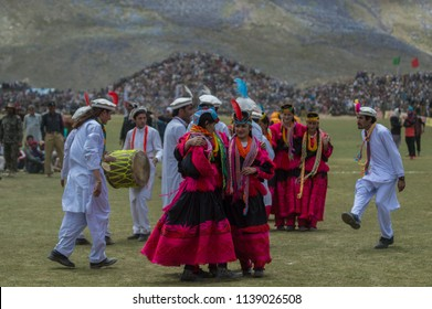 Chitral, Khyber Pakhtunkhwa / Pakistan - July 9 2018: Kalash people dancing at the Shandur - world's highest polo-ground.
