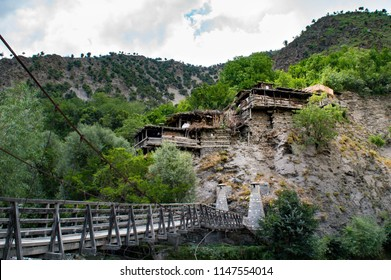 Chitral, Khyber Pakhtunkhwa / Pakistan - July 29 2018: A village built on a mountain slope in Birir valley in Kalash.