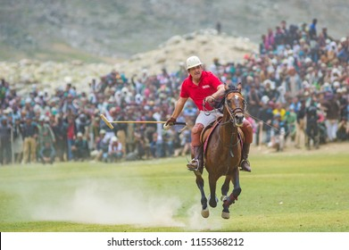 Chitral, Khyber Pakhtunkhwa / Pakistan - July 9 2018: A horse running towards the center of the ground in a polo match played at Shandur - the highest polo ground of the world.
