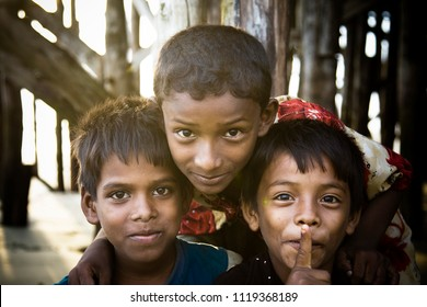 Chittagong, Bangladesh - 06 16 2009: A group of local beach children posing for the camera smiling
