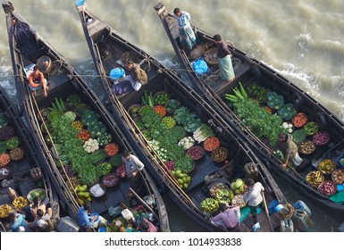 Chittagong / Bangladesh - 13 March 2017: Floating bazar in Bangladesh, salesmen offering food, fresh vegetables, meat.