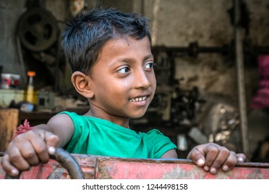 Chittagong, Bangladesh - apr 27 2018: portrair of worker-boy, who works in Chittagong ship-breaking yard