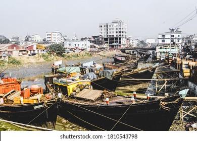 Chittagong, Bangladesh, December 23, 2017: Fishng boats in a canal near fish market in Chittagong, Bangladesh