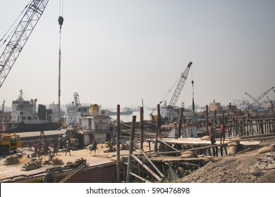 CHITTAGONG, BANGLADESH - FEBRUARY 2017: The port with many people and boats in the center of Chittagong in Bangladesh