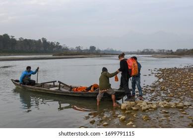 Chitwan, Nepal - 21 January 2020: tourists on a canoe safari at Chitwan national park on Nepal
