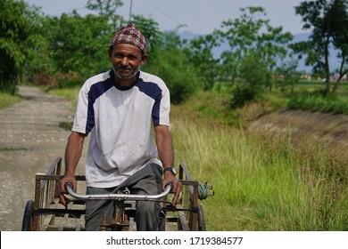 Chitwan Nepal ,26 April 2020 :Rickshaw puller posing for a camera from Chitwan Nepal.