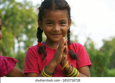 Chitwan Nepal,01 September 2020:Nepali girl posing for a camera while doing Namaste from Chitwan Nepal.