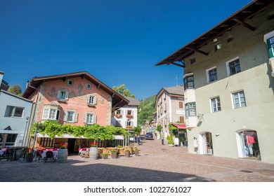 Chiusa, Italy - August 4, 2017. Central square restaurants and stores