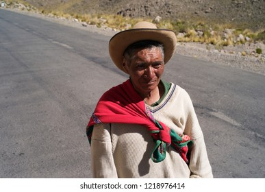CHIVAY, PERU - JULY 21, 2010: A peruvian farmer walking down the rural road Carretera 1S near Chivay, in the Arequipa Region of Peru.