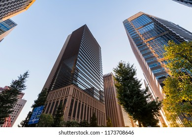 "CHIYODA, TOKYO / JAPAN - AUGUST 25 2018 : Evening scenery of ""Otemachi"" where business buildings stand side by side."