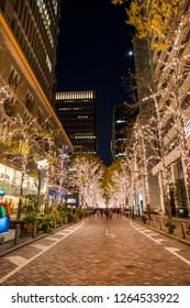 "CHIYODA, TOKYO / JAPAN - DECEMBER 15 2018 : Scenery of Christmas illumination of Tokyo Marunouchi. ""Marunouchi Nakadori Street"" is colored with gold bulbs."