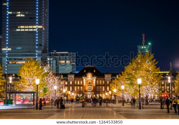 CHIYODA, TOKYO / JAPAN - DECEMBER 15 2018 : Scenery of Christmas illumination of Tokyo Marunouchi. A gold bulb shines in the square in front of the Tokyo station.