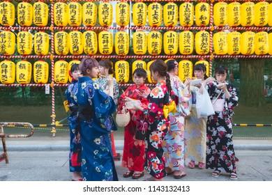Chiyoda, Tokyo / Japan - July 15th 2018: Group of Japanese girls wearing traditional kimono at the Mitama Matsuri festival in summer at the shinto shrine Yasukuni Jinja in Tokyo.