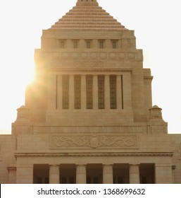 Chiyoda, Tokyo, Japan - March 14, 2019 : National Diet Building is the center of Japan' politics as it is the place where Diet sessions are held. It's a scene that is shining  in gold with the sun