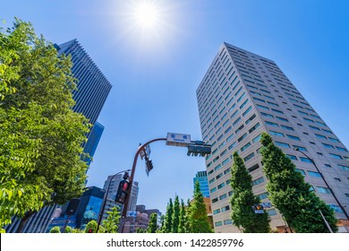 """CHIYODA, TOKYO / JAPAN - MAY 23 2019 : The scenery in front of """"Ochanomizu"""" station. There is a building of """"Ochanomizu sola city"""". It is a complex of university, conference hall and office."""