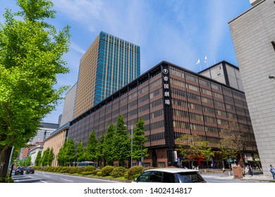 """CHIYODA, TOKYO / JAPAN - MAY 5 2019 : The scenery of """"Imperial Theatre"""" in Tokyo Marunouchi. Musicals and plays are performed. On the top floor is the """"Idemitsu Museum of Arts""""."""