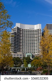 CHIYODA-KU, TOKYO, JAPAN - NOVEMBER 23rd 2017. The Palace Hotel in the Marunouchi district of Tokyo. Bright colorful autumn leaves on the trees.